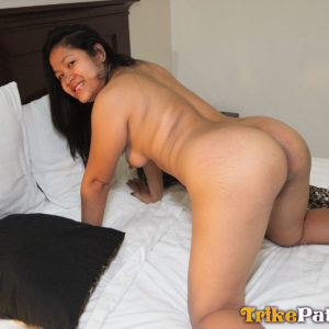 Mature Filipina mom in bed showing ass