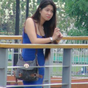 Asian babe in blue dress at park