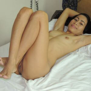 Petite Asian Girl laying on back