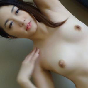 Pretty Filipina chick showing small tits