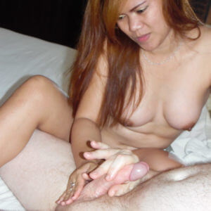 Chubby Asian Slut massaging balls