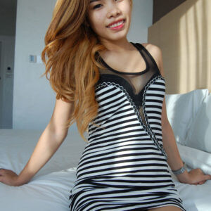 Hot Young Asian on bed in striped top