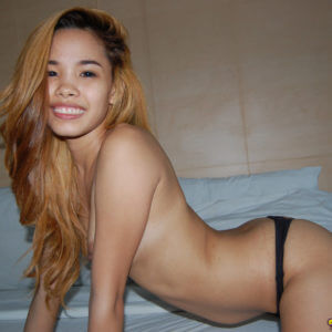 Hot Young Asian girl smiling topless