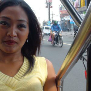 Filipina in trike patrol ride