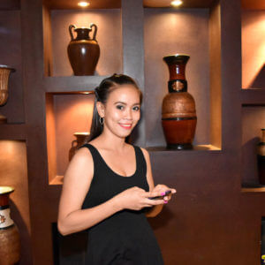 Pretty Pinay girl Marie using cell phone in hotel
