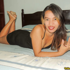 Filipina on hotel bed before sex