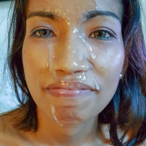Slutty Asian Girl with cum on her face