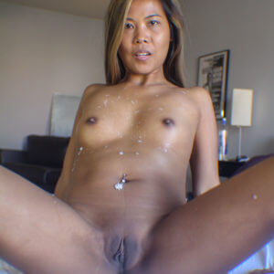Petite Asian MILF with cum on her tits