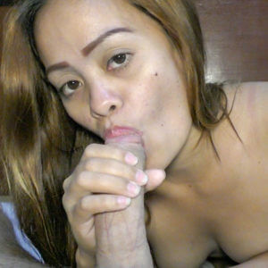 Filipina giving head to white guy