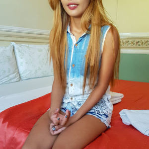 Cute Filipina teen on bed