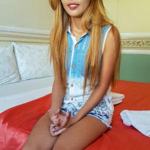 Cute Filipina teen on bed